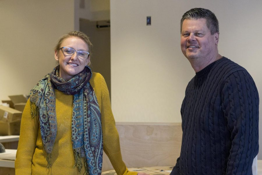 Kru Coffee manager Lisa Weber (Left) and owner Kyle Brock stand in the unfinished cafe space, Jan. 29. The building, located at 2 Church St., is Kru's second location.