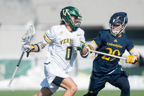 Sophomore midfielder Sal Iaria battles a Quinnipiac player during UVM's home opener, Feb. 22. UVM won the game 16-7.