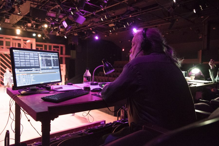 "John Forbes, professor and resident lighting designer, monitors computer readouts during a rehearsal of the theater department's ""Shakespeare in Love,"" Feb. 18. Forbes has a Master of Fine Arts in theatre lighting design from University of Massachusetts, Amherst."