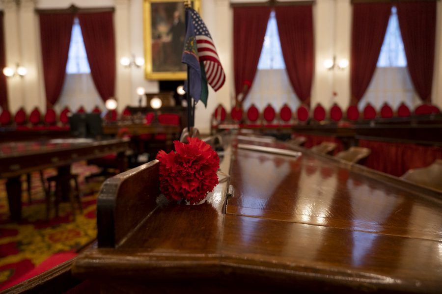 A red carnation lays on the desk in the Statehouse chambers, Feb. 13. Carnations are most often representative of love and affection.