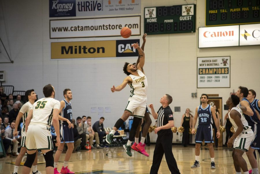 Senior forward Anthony Lamb reaches for the ball at a home game against University of Maine Feb. 5. UVM athletics has cancelled the remainder of the 2019-2020 athletic season, following a slew of other athletic cancellations.