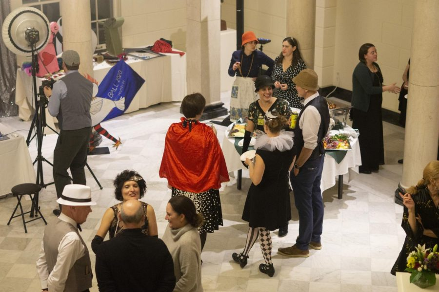 Attendees of the Costume Art Ball stand in their costumes for the opening of new exhibits, Feb. 20. Food, drinks and live music were offered at the event.