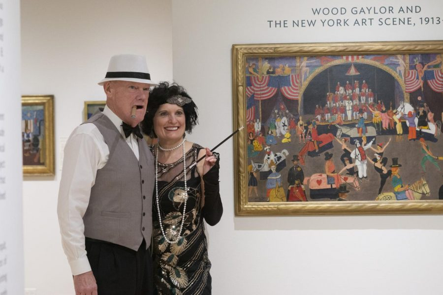 UVM provost and senior vice president, and husband Billy Prelock pose for a photo in costumes by the Wood Gaylor exhibit in Fleming Museum, Feb. 20. The exhibit is open from Feb. 7 to May 8.