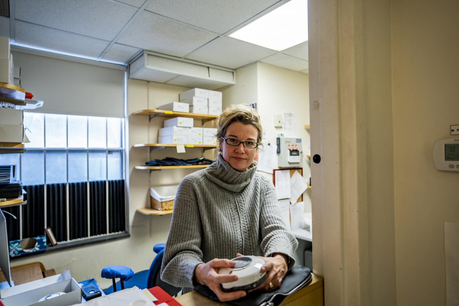 """Stacey Sigmon holds a """"medi wheel"""" device in her clinic in the Vermont Center for Behavior and Health, Feb. 3. The new UVM Center on Rural Addiction is dedicated to addressing the opioid issue within rural communities through developed research."""