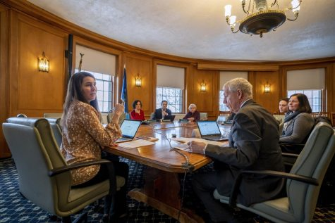 Members of the board of trustees prepare for the March 2 meeting where they selected Ron Lumbra to be the new chair and established the new sustainability work group.