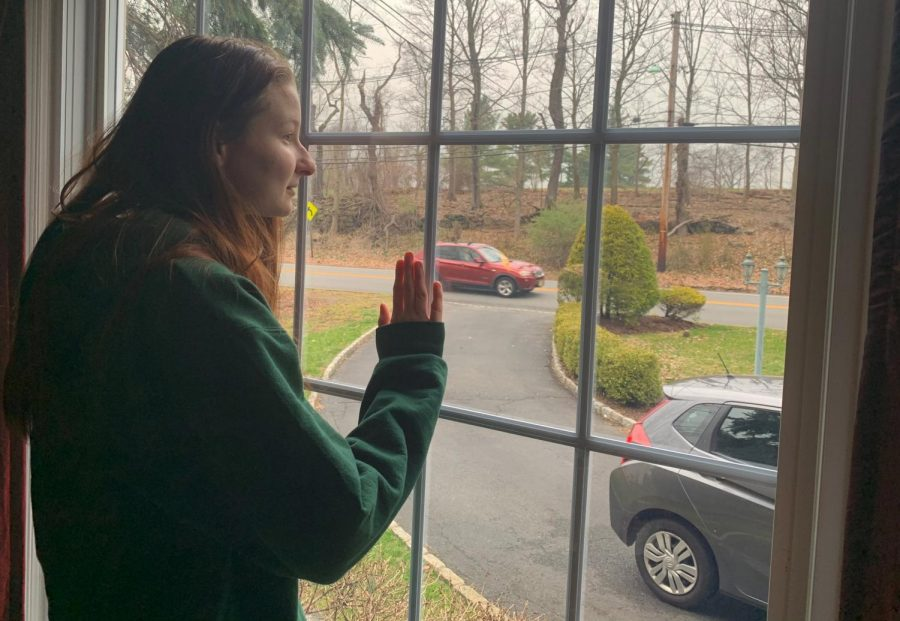 Sophomore Emily Johnston stares longingly out the window of her New Jersey home, Mar. 31.