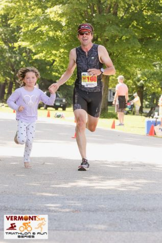 Stapleton and his daughter run during an Olympic Triathlon at Lake Dunmore in 2018.
