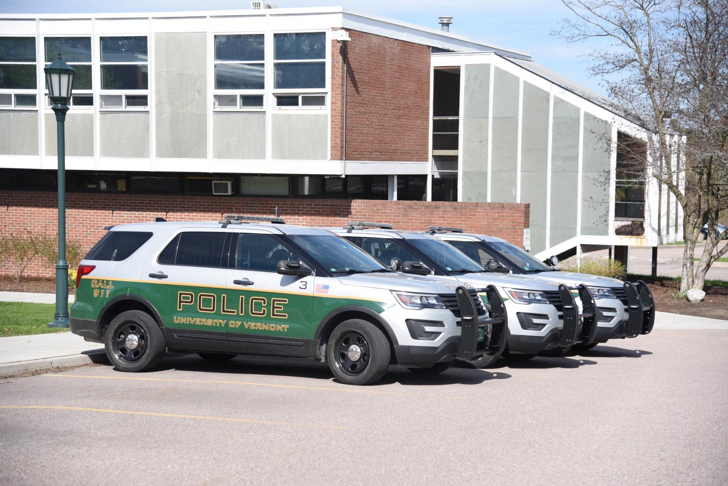 UVM Police cars sit outside the departments headquarters May 2, nearly two months after most students have vacated campus.
