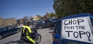 Protestors gather in the Waterman Parking lot May 14. Waterman is home to the offices of UVM executives including President Suresh Garimella.