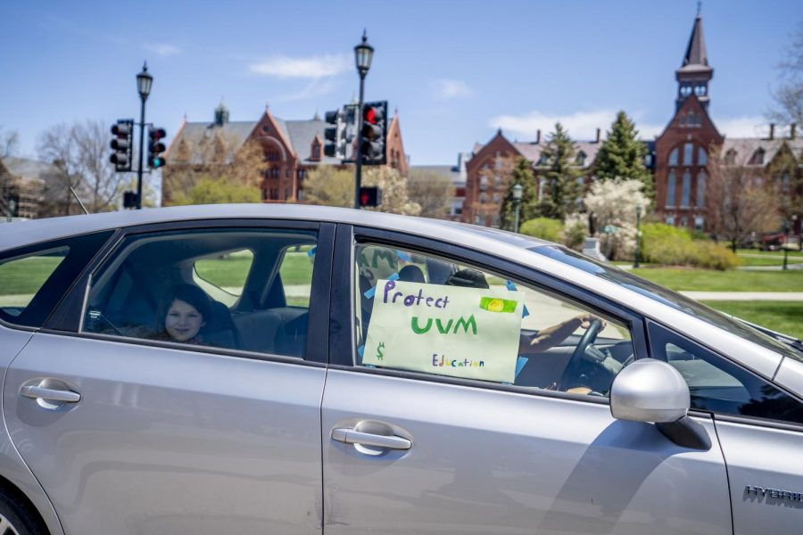 UVM community members drove in a loop around portions of the campus May 14. This community member's sign of solidarity reads