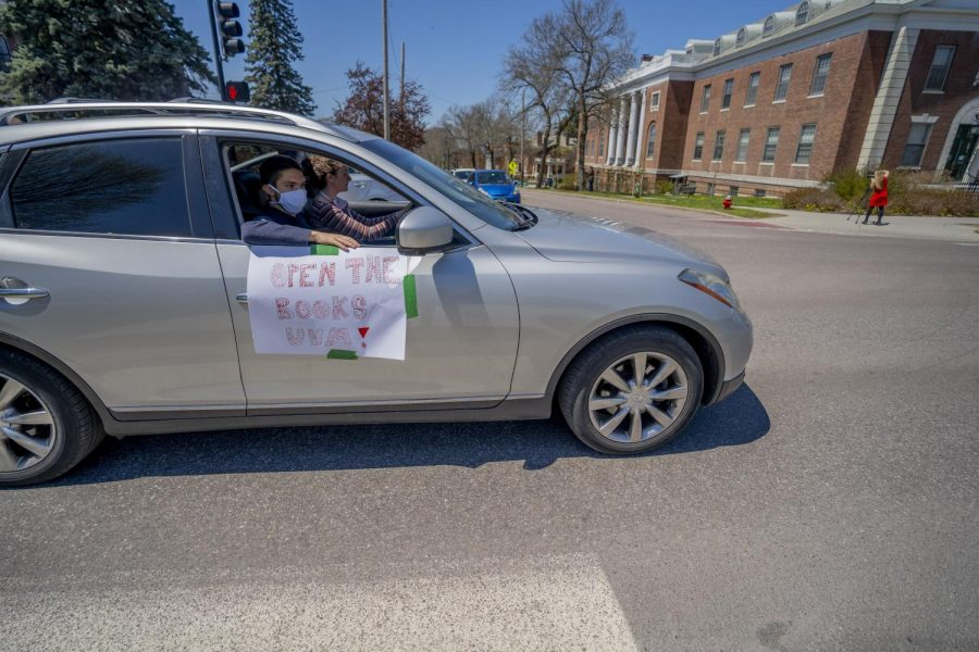 A car full of protestors turn onto College Street from South Prospect May 14, 2020. The sign reads