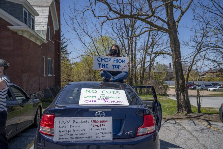 Associate UVM Professor Sarah Alexander  sits atop her car in the Waterman parking lot May 14, 2020.
