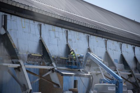 Construction workers work on the Multi-purpose center May 26.