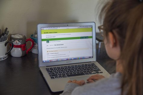 UVM Junior Julianne Lesch looking over the form for selecting at-home learning July 8.