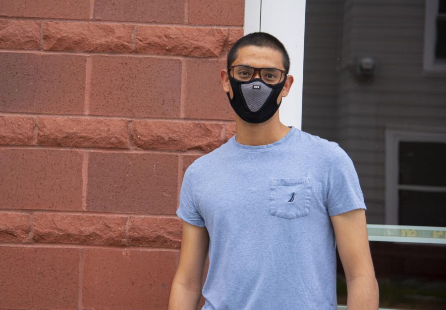 Shuvan+Shrestha+standing+outside+of+University+Heights+North+June+24.