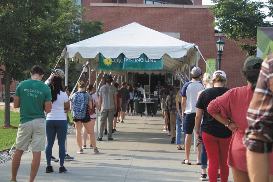 UVM+students+stand+in+a+long+line+outside+of+the+Davis+center+Covid+testing+site%2C+Sept.+10.