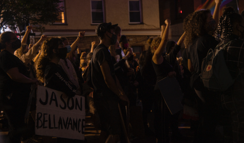 Hundreds of protesters raised their right fist as organizers spoke outside Burlington City Hall Wednesday night in a call for racial justice and an end to police violence.