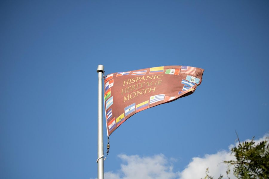 A Hispanic Heritage month flag blows in the wind on a flagpole in front of the Davis center, Sept. 18.