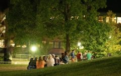 A group of students sit together on the Redstone Green, Sept. 11. Students had gathered in large groups several days before over Labor Day weekend, drawing UVM Police to the scene.