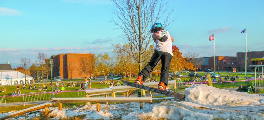 A snowboarder hits the rails in front of a crowd of socially distanced viewers behind University Heights South Oct. 23.
