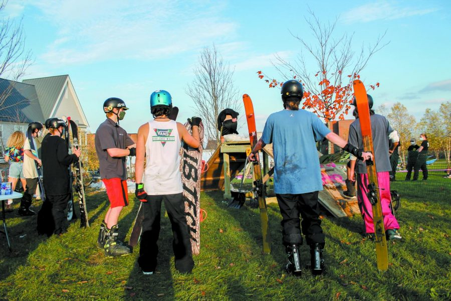 Skiers and boarders wait in line for their turn to hit the rails as the 60 degree heat melts the snow Oct. 23.