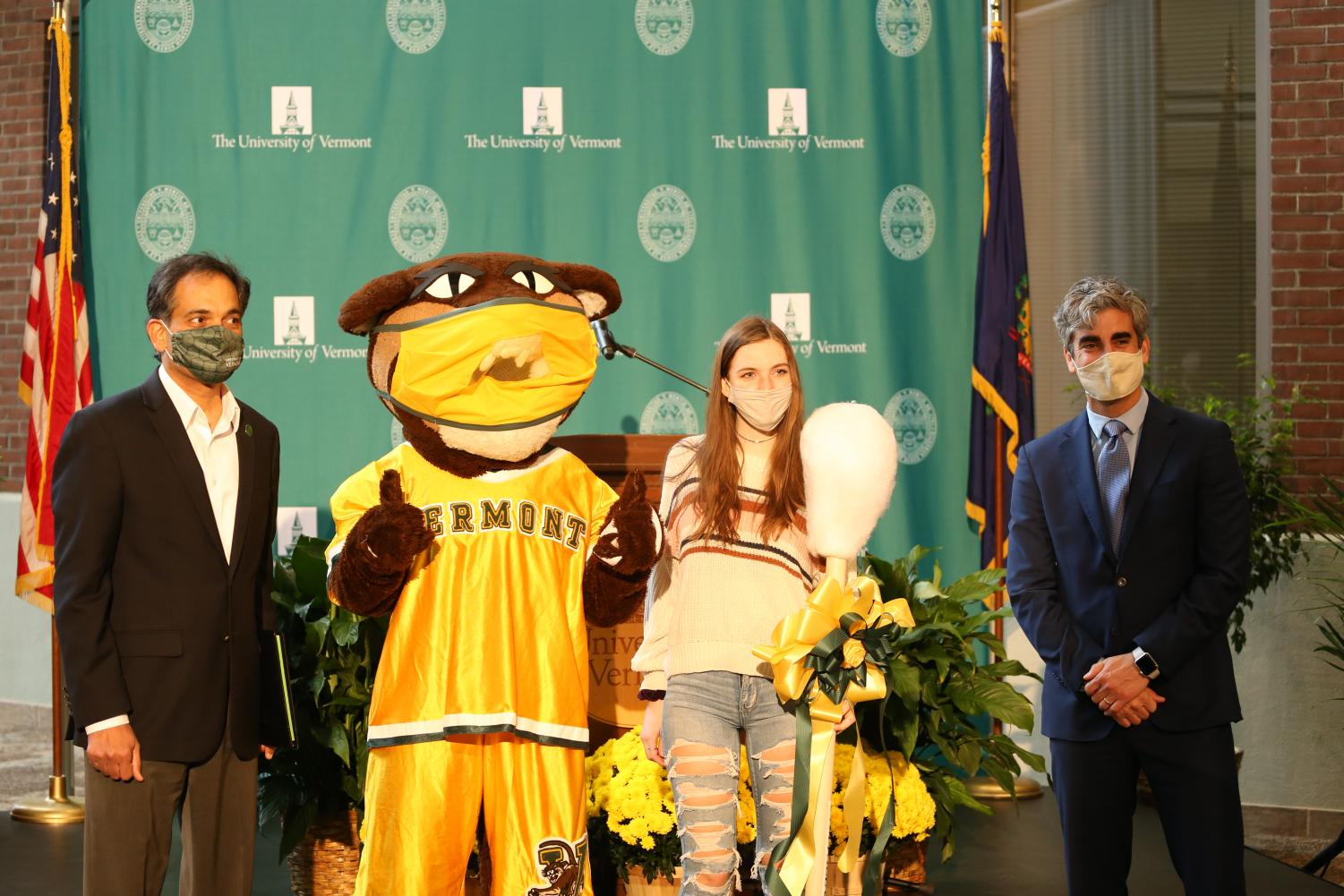 UVM President Suresh Garimella, Rally Cat, first-year Emily Scarborough and Burlington Mayor Miro Weinberger pose for a photo in the David Center Atrium to celebrate UVM