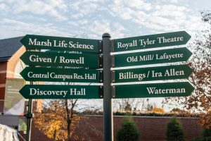 Street signs outside the Davis Center point students and visitors towards different campus buildings outside the Davis Center.