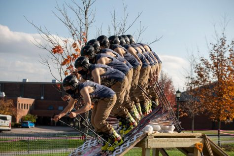 A skier from the UVM Ski and Snowboard Club launches from the top of the pitch, setting up to hit the rails below Oct. 23.