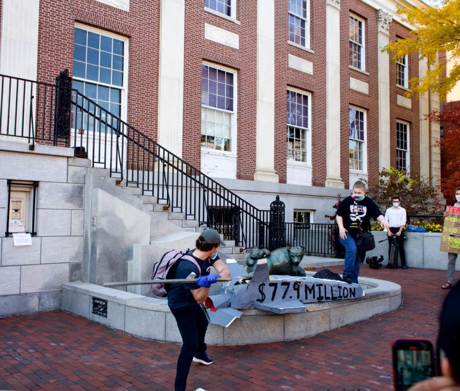 Climate strike participants smash a replica of an F-35 in front of City Hall, Oct. 23.