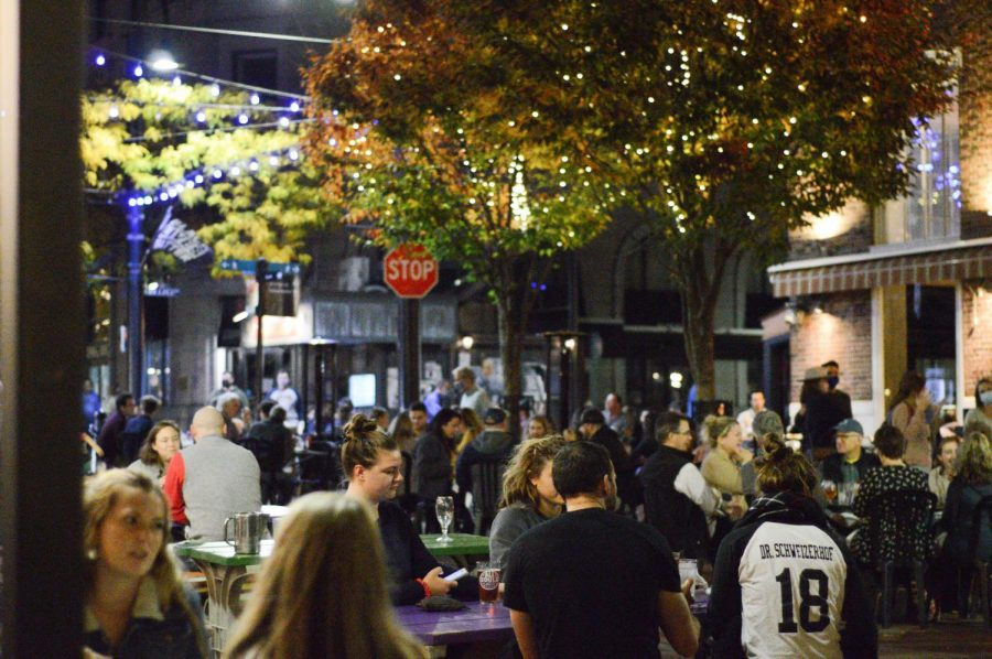A group of restaurant goers sit outside of Sweetwaters on Church Street, Oct 23.
