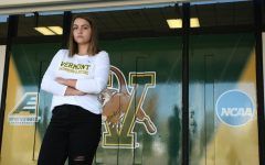Junior Kendall Ware stands in her Vermont Swimming and Diving shirt in front of the Patrick Gym, Oct. 9. Ware will be graduating this year to enter a Speech Pathology grad program at UVM.