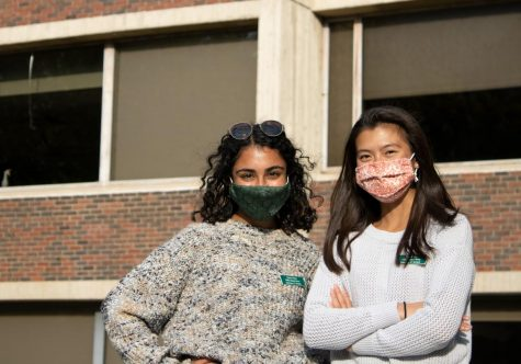 Juniors Tasha Kalra and Sophie Tom stand in front of Rowell Hall, Oct. 9. Kalra and Tom are both a part of the nursing program at UVM.