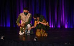 Suresh Garimella (left) and his wife Lakshmi light the ceremonial lamp that signifies the start of Diwali Nov. 14.