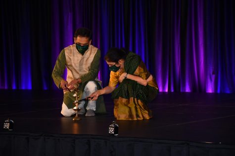 Suresh Garimella (left) and his wife Lakshmi light the ceremonial lamp that signifies the start of Diwali Nov. 14.