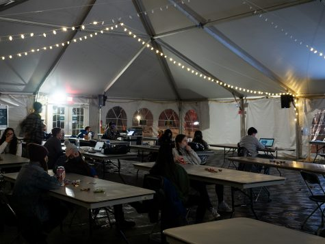 "Nervous students watch election night news coverage in a tent of the Davis Center green Nov. 3. ""I"