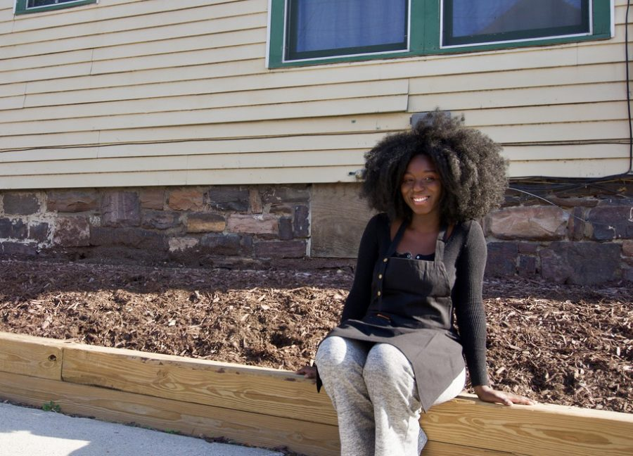 Harmony Edosomwan, creator of Harmony's Kitchen, sits outside of her apartment where she does the cooking for her business.