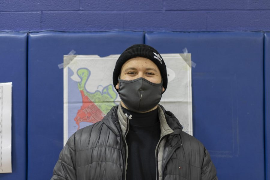 Senior year medical student Ryan Cournoyer stands in the Mater Christi School gymnasium Nov. 3