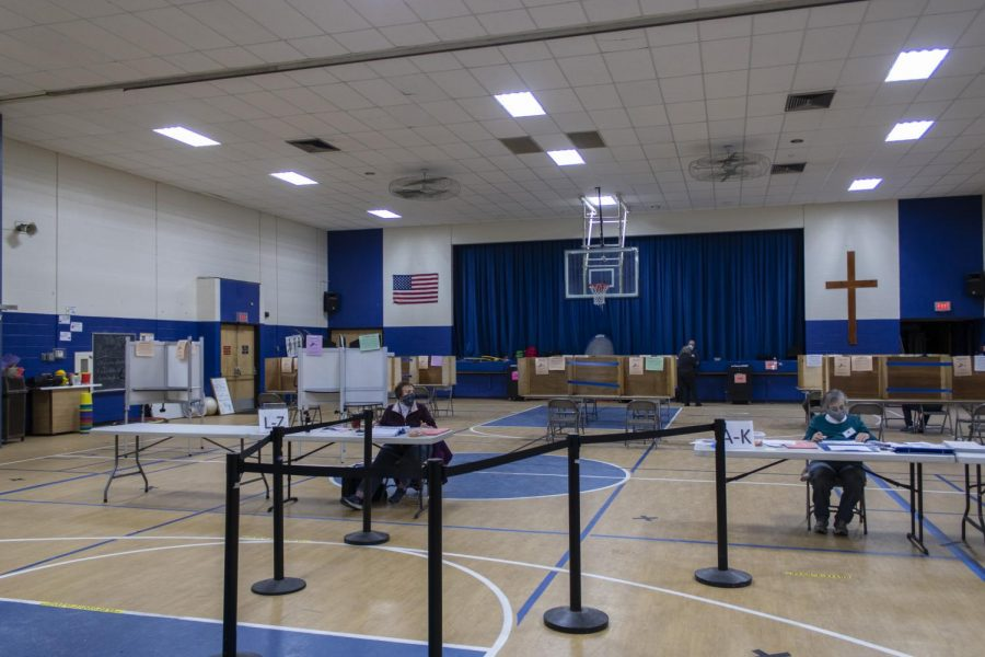 The Mater Christi Schools gymnasium is transformed into a polling place for Ward 1 voters Nov. 3.
