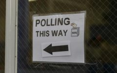 Signs point to the polling place for potential voters Nov. 3.