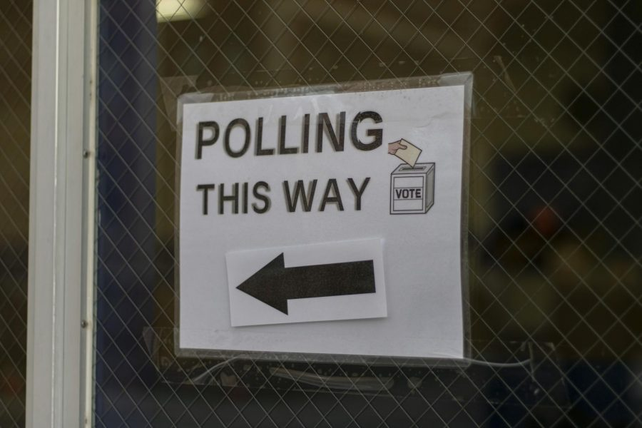 Signs indicate where the entrance to the polling place is to potential voters Nov. 3.