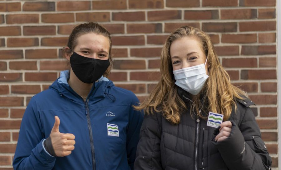 Junior Olivia Gaissert (left) and Sophomore Waseya Lawton (right) stand outside the Mater Christi School Nov. 3. Both students decided to drop off their mail-in ballots in person instead of mailing them in.