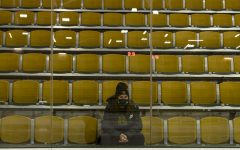 Sophomore Cam Morrissey sits in the empty bleachers of the Gutterson Fieldhouse Dec. 6. Morrissey trains with her team five days a week during the winter.