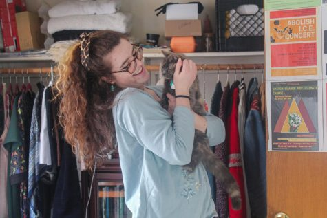 UVM Senior Anna Shea holds her cat Pesto in her off-campus apartment Jan. 30.