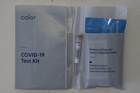 A Color COVID-19 testing kit is opened to display the contents of the kit Jan. 25. The kit includes a nasal swab, a testing tube, a biohazard bag and a return shipping mailer.