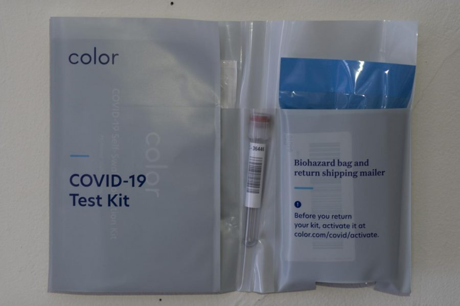 A+Color+COVID-19+testing+kit+is+opened+to+display+the+contents+of+the+kit+Jan.+25.+The+kit+includes+a+nasal+swab%2C+a+testing+tube%2C+a+biohazard+bag+and+a+return+shipping+mailer.+
