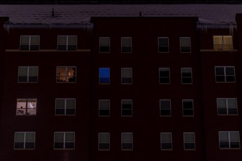 Four rooms inside of Central Campus Residence Hall are lit up Jan. 21.