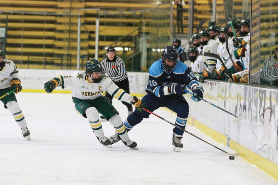 Andrew Lucas, UVM sophomore and defensemen for the men's hockey team faces off against the University of Maine in the Gutterman Fieldhouse earlier this season.