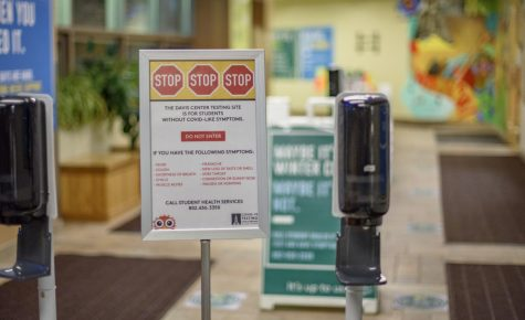 A sign in the entryway of the Davis Center COVID-19 testing location warns students that if they have symptoms they cannot test at this location. As the number of COVID-19 cases has increased at UVM over the last three weeks, officials put in place new restrictions Feb. 25.