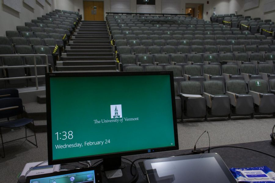 The monitor in Billings-Ira Allen lecture hall displays a UVM screen saver Feb. 24. The empty lecture hall is where Associate professor and Directory of Graduate Studies Jacques Bailly teaches his in-person classes this semester.