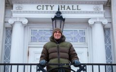 Max Tracy 2021 Burlington Mayoral Candidate stands at the top of the City Hall steps Feb. 18.